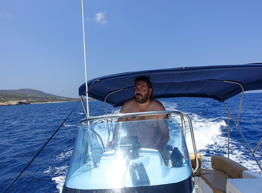 Driving-a-boat-to-the-blue-lagoon-in-cyprus