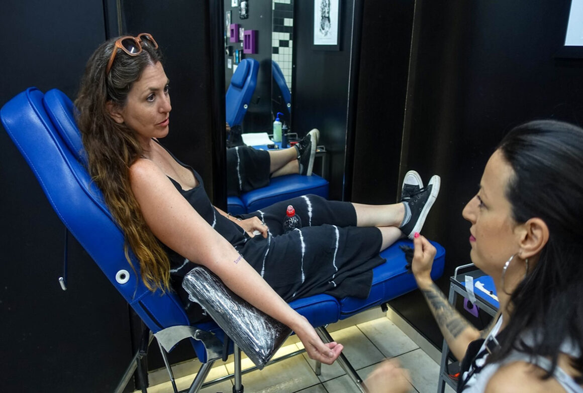 mimi-getting-a-tattoo-in-athens-greece